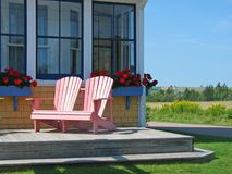 Country Inn Deck Chairs. Deck chairs sitting on the patio of a country inn stock images