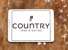 Country Inns and Suites logo. Logo of Country Inns and Suites on samsung tablet. Country Inns and Suites by Radisson is an American hotel brand owned by the royalty free stock photos