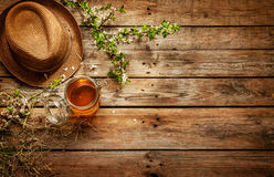 Country - jar of honey, gardener's hat and blooming tree branch Stock Photography
