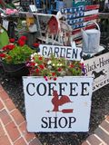 Country Junk. Country shops and signs arranged outside with red, black, and white dominating colors royalty free stock images