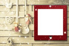 Country kitchen Christmas frame. Red Christmas frame in country kitchen on wooden boards with ornaments in vintage utensils Royalty Free Stock Image