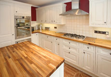 Country Kitchen Interior. Interior of modern cottage-style kitchen with integrated appliances Stock Photo