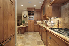 Country Kitchen With Oak Cabinetry Stock Photos