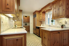 Country kitchen with wood cabinets Stock Photos