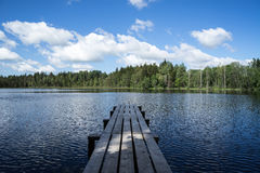 Country lake with clouds. In latvia Royalty Free Stock Photo