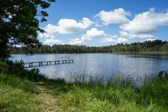 Country lake. With clouds in latvia Royalty Free Stock Image
