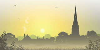 Country Landscape. A Misty Country Landscape with Church Spire and Trees Stock Photos