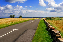 Country landscape. With lonely way in side of sea Royalty Free Stock Photo