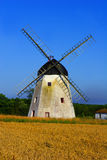 Country landscape. With windmill and field of wheat Royalty Free Stock Images