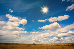 Country landscape in background of sky with clouds and sun Stock Photography