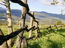 Country landscape with fence in foreground Royalty Free Stock Images