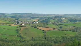 Country Landscape With Fields And Houses. Panoramic view of a small village in the countryside in the summer stock footage