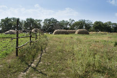 Country Landscape. Haystacks and corral for horses Royalty Free Stock Photos