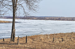 Country landscape with melting ice on a river Stock Photo