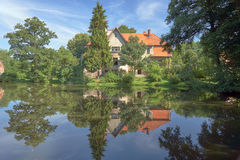 Country landscape with a pond and the palace Stock Images