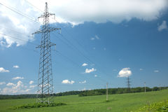 Country landscape with power line metal pilons Stock Photos