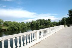 Country landscape with white balustrade Stock Image