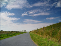 Country lane at the dike Stock Photos