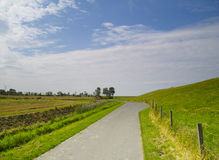 Country lane at the dike Stock Photography