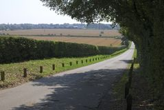 Country lane down hill in Sussex. UK Stock Photos