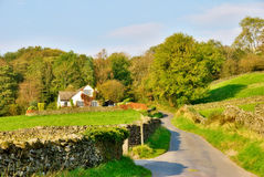 Country lane leading to a house Stock Images