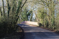 Country lane over Ashby Canal bridge. Bridge over Ashby Canal in winter stock photo