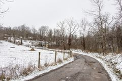 Country lane in rural Applachia in winter stock photography