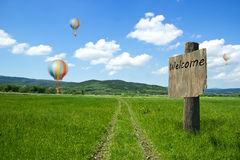 Country Lane to Mountain with Flying Balloons Stock Image