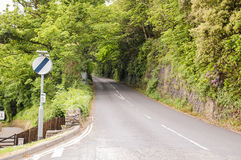 Country Lane With National Speed Limit Sign Stock Image