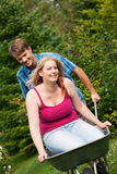 Country life – couple with wheelbarrow Stock Images