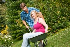 Country life – couple with wheelbarrow Stock Image