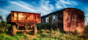 Country life. The tractor trailer in the village Stock Photography