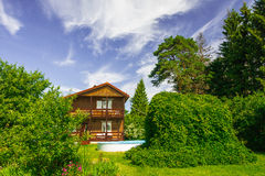 Country Lodge. Cottage in the suburbs at their summer Stock Images