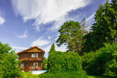 Country Lodge. Cottage in the suburbs at their summer Royalty Free Stock Image