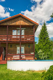 Country Lodge. Cottage in the suburbs at their summer Royalty Free Stock Photos