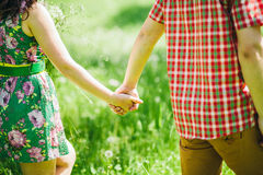 Country love story couple in green summer meadow Royalty Free Stock Photography