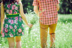 Country love story couple in green summer meadow Royalty Free Stock Image