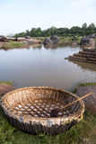 Country made coracle boat. A circular shaped country boat to cross the river in Hampi stock photography