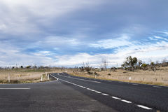 Country main road at intersection fading into the distance Royalty Free Stock Photography