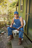 Country Man in overalls with Shotgun Stock Photos