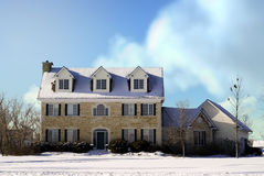 Country Manor. A large three story house made of stones taken during the winter Stock Photos