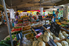 Country Market in Provence. Shoppers survey fresh produce at an open air market in Provence, France Royalty Free Stock Photos