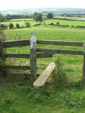 A country mile. Looking over a country stile and surveying the long walk ahead Stock Photo