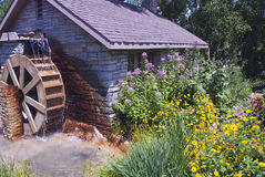 Country mill with waterwheel  Royalty Free Stock Image