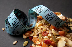 Country Mix Diet. This is an image of a measuring tape and some contry mix fruits stock photo