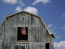 Flag in barn hay loft Stock Photography
