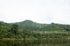 Reservoir with mountains and jungle in the back. royalty free stock photo