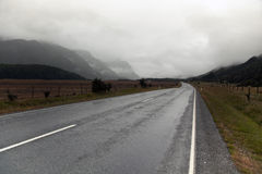 Country mountain road in rain and clouds. Endless country mountain road in rain and clouds royalty free stock photography