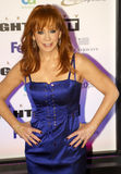 Country music artist and actress Reba McEntire. American country music artist and actress, Reba McEntire, attends Celebrity Fight Night on March 19, 2001, at the royalty free stock image