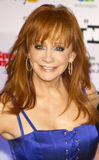 Country music artist and actress Reba McEntire. American country music artist and actress, Reba McEntire, attends Celebrity Fight Night on March 19, 2001, at the royalty free stock photos